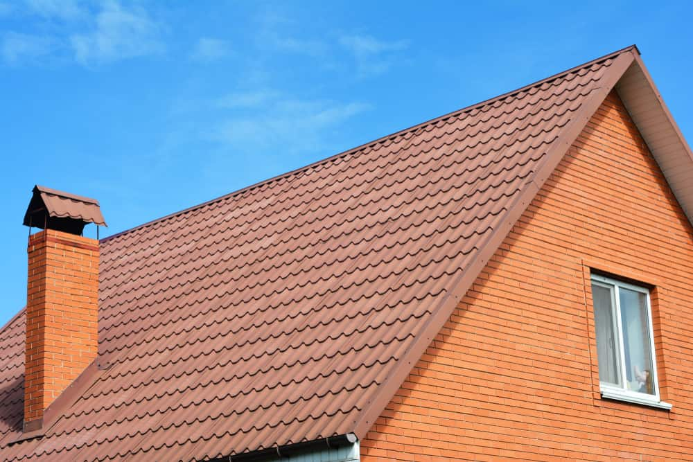 close up image of house with brown tiled roof